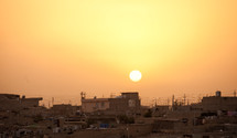 sunset over an Iraqi city
