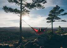 relaxing in a hammock on a mountaintop