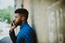 a man talking on a cellphone