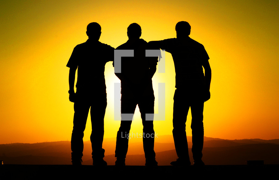 silhouette of three men