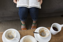 woman witting on a couch reading a Bible and breakfast