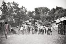 Man walking with children in village
