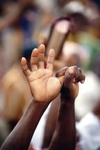 Hands raised in praise. Decision for Christ. Evangelism.