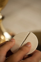 breaking a wafer at communion