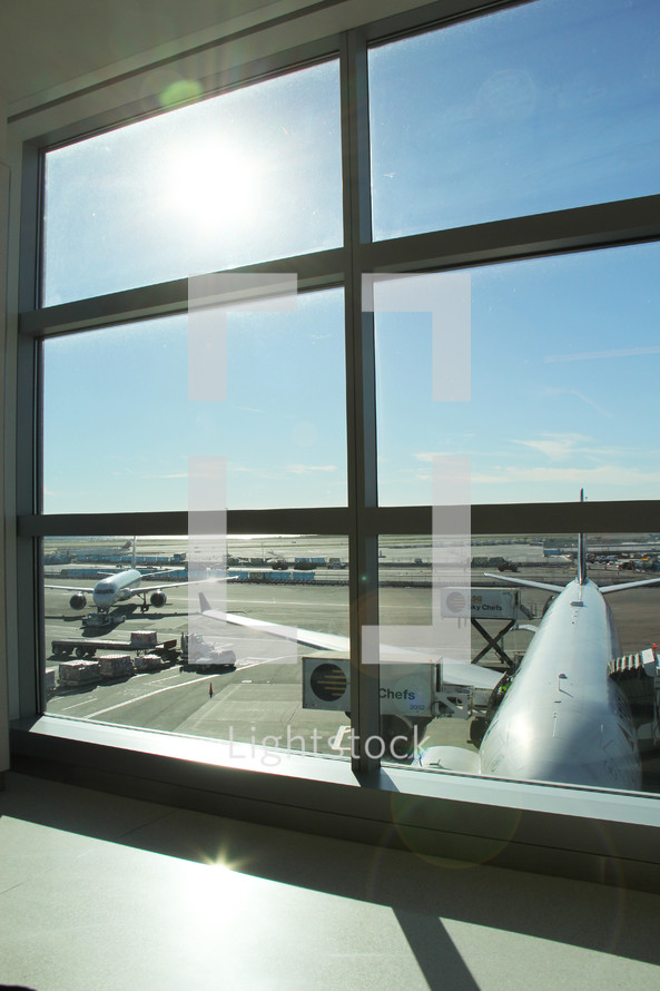 view of the tarmac out a window at an airport