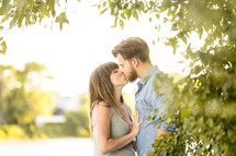 a couple kissing outdoors