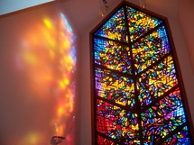 The Healing Window -  chapel with a large stained glass window that reflects the glowing light of Heaven on its walls