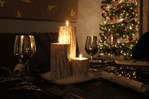 Christmas meal, cups, candles and tree