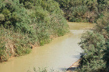 The Jordan River, possible location of Jesus' baptism, in Jordan