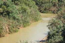 The Jordan River, possible location of Jesus' baptism, in Jordan