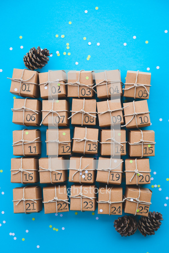 advent calendar presents and pine cone