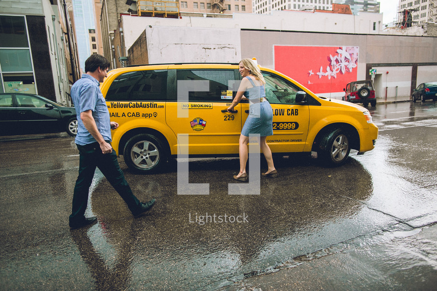 A couple catching a taxi.