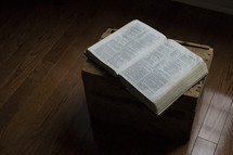 open Bible on a wood crate