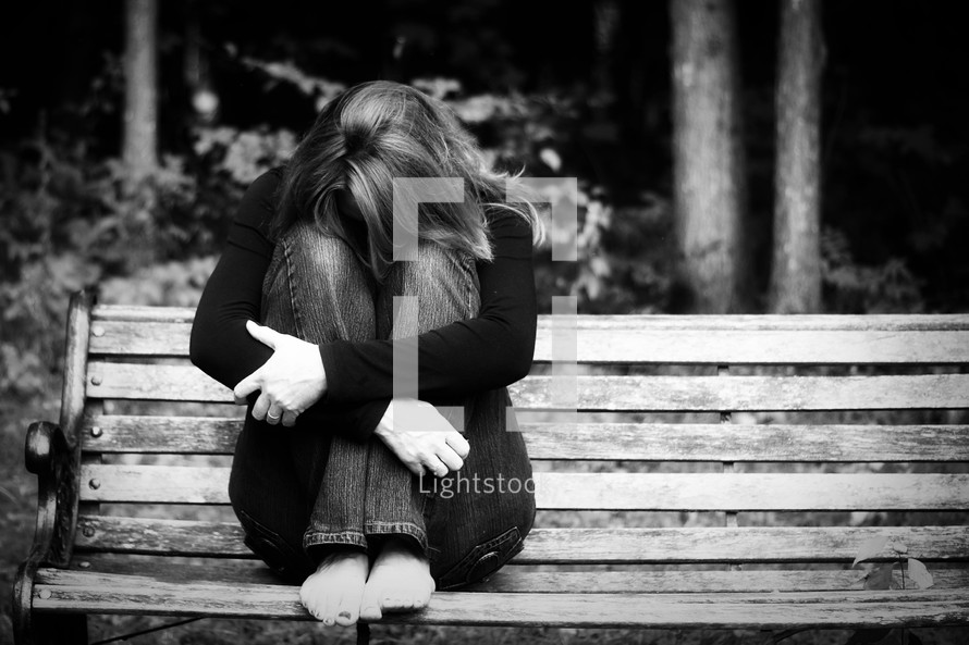 depression - woman sitting on a bench
