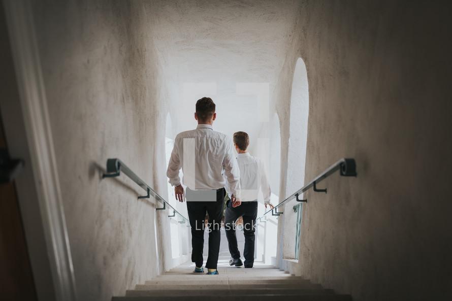 groomsmen walking down a stairwell
