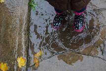 a girl in rain boots