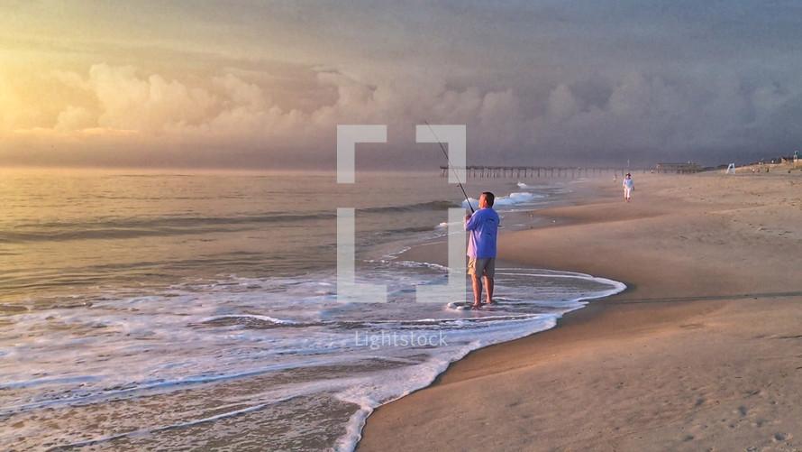 man fishing on a beach