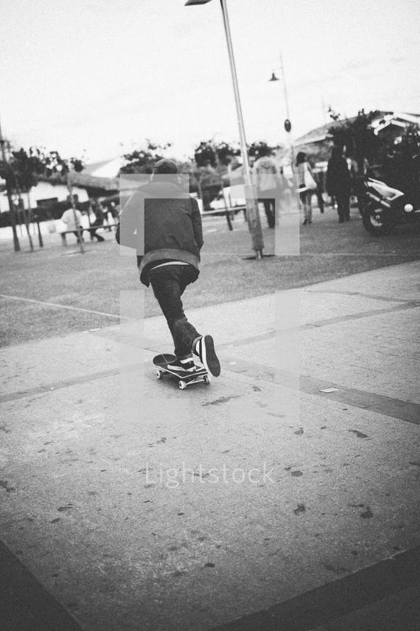 teen boy skateboarding