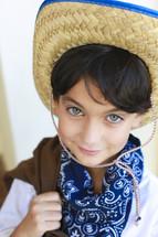 Boy wearing a bandana and hat