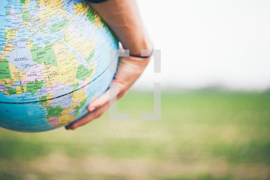 hand around a globe