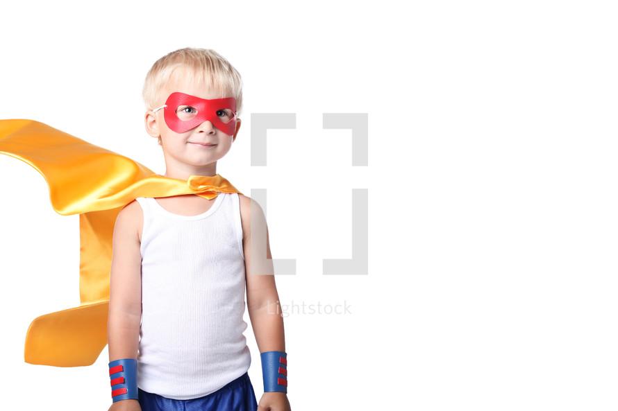 little kid dress up as super hero.