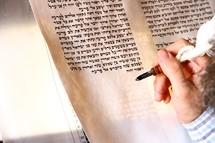 A Rabbi hand-writing the Torah