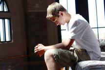 teen boy praying