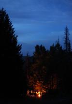 teens standing around a campfire