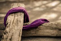 purple shroud on a wooden cross
