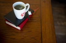mug of hot tea on a stack of books