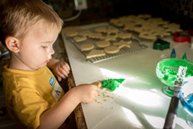 toddler decorating Christmas cookies