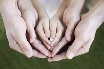cupped hands of a family