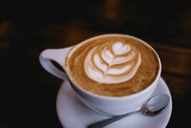 design in creamer in a coffee cup