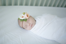 swaddled newborn baby girl