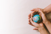 globe in cupped hands