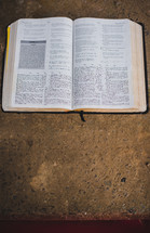 open Bible on a concrete