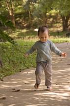 toddler boy learning to walk