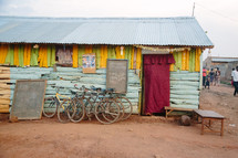 bikes parked in front of a house in Africa