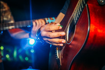 a person strumming a guitar