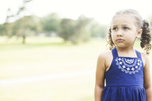 toddler girl in pig-tails