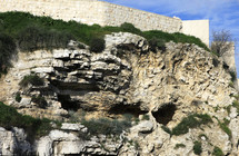 caves, a rocky escarpment that some say looks like Golgotha