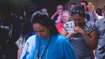 group prayer during a worship service