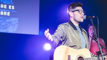 worship leader singing on stage