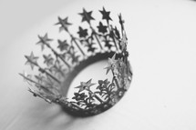 A crown rests on a white backdrop.