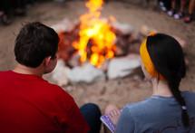 teens sitting around a campfire