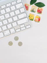 keyboard, stamps, leaves, sparkle dots, workspace, desk, home office