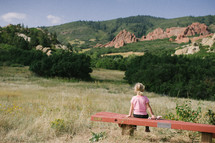 girl child sitting on a bench outdoors