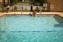 father and son at a swimming pool