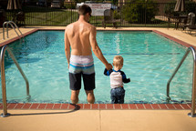 father and son at a public pool