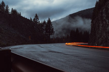 taillights blurring has they travel on a curvy mountain road